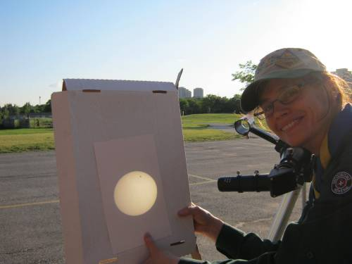 The Sunday artist holding the pizza cardboard - with the Venus transit